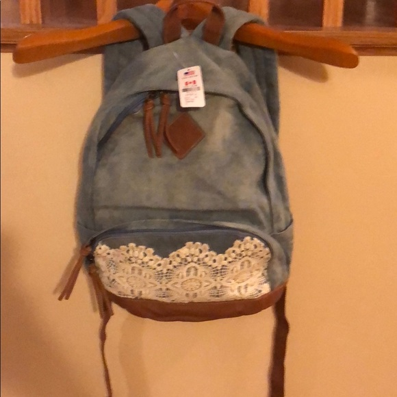 ba84435255 Claire s Handbags - Denim Backpack with lace trim on pocket